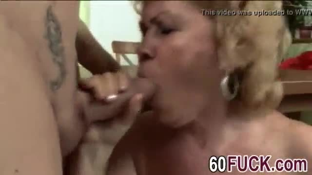 A slutty big tit granny masturbates and rides young studs hard penis